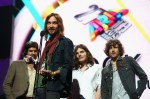 SYDNEY, AUSTRALIA - DECEMBER 01:  Tame Impala accept the award for 'Best Rock Album' during the 27th Annual ARIA Awards 2013 at the Star on December 1, 2013 in Sydney, Australia.  (Photo by Ryan Pierse/Getty Images)